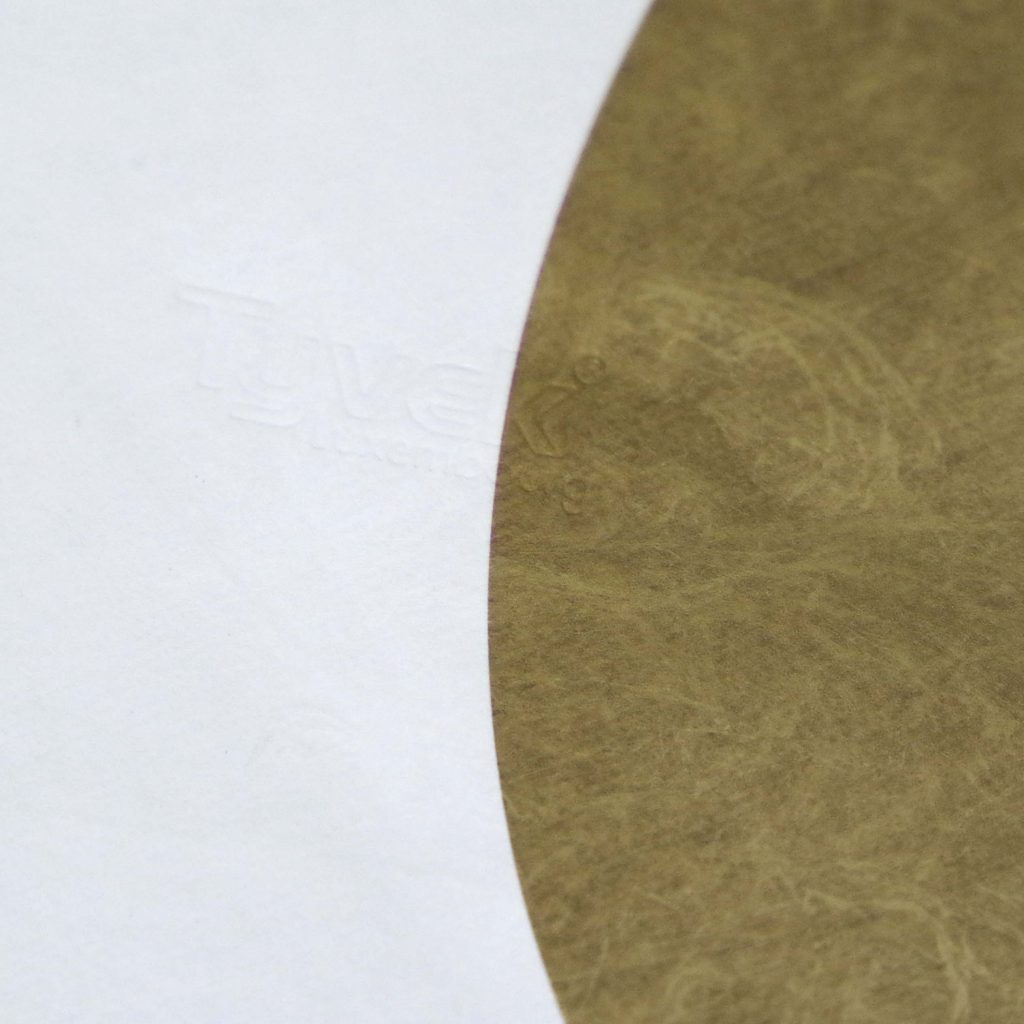 Close up of Tyvek envelope showing texture and gold print