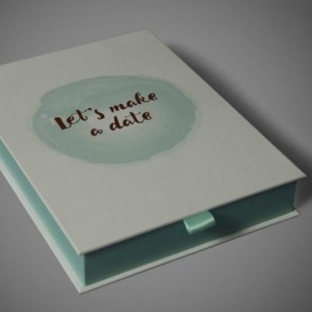 Bespoke 'book box' with magnet and ribbon, paper over board construction.